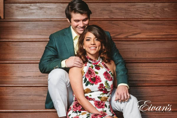engagement couple sitting on stairs