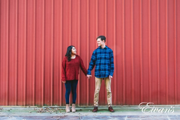 engaged couple in red and blue complimentary outfits