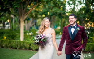 bride and groom wearing frost blush and boysenberry colors
