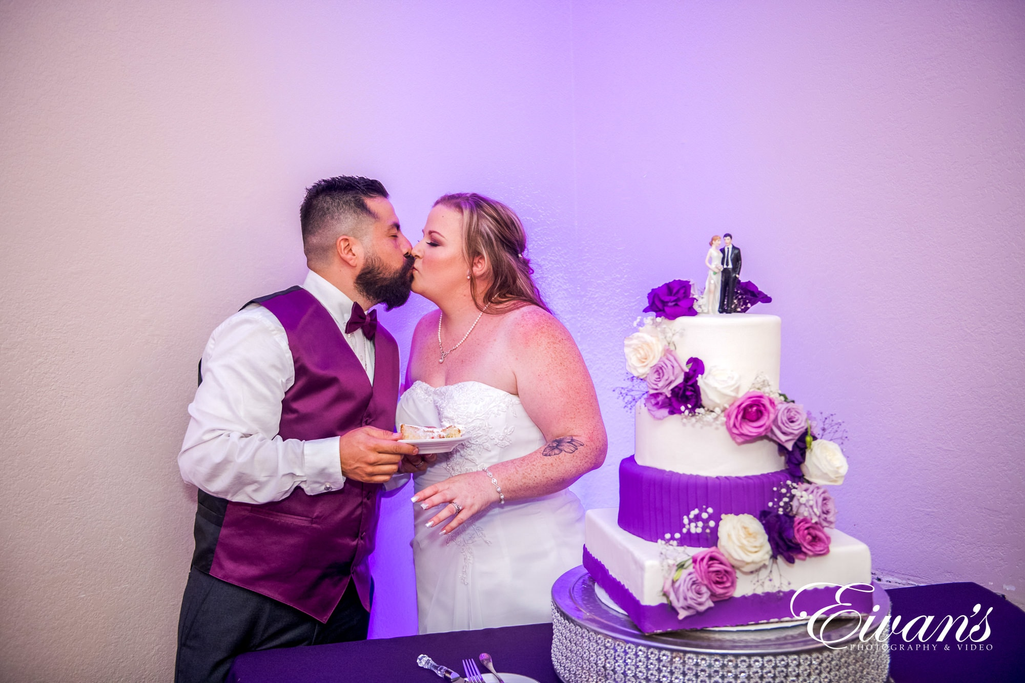 bride and groom wear lilac and violet