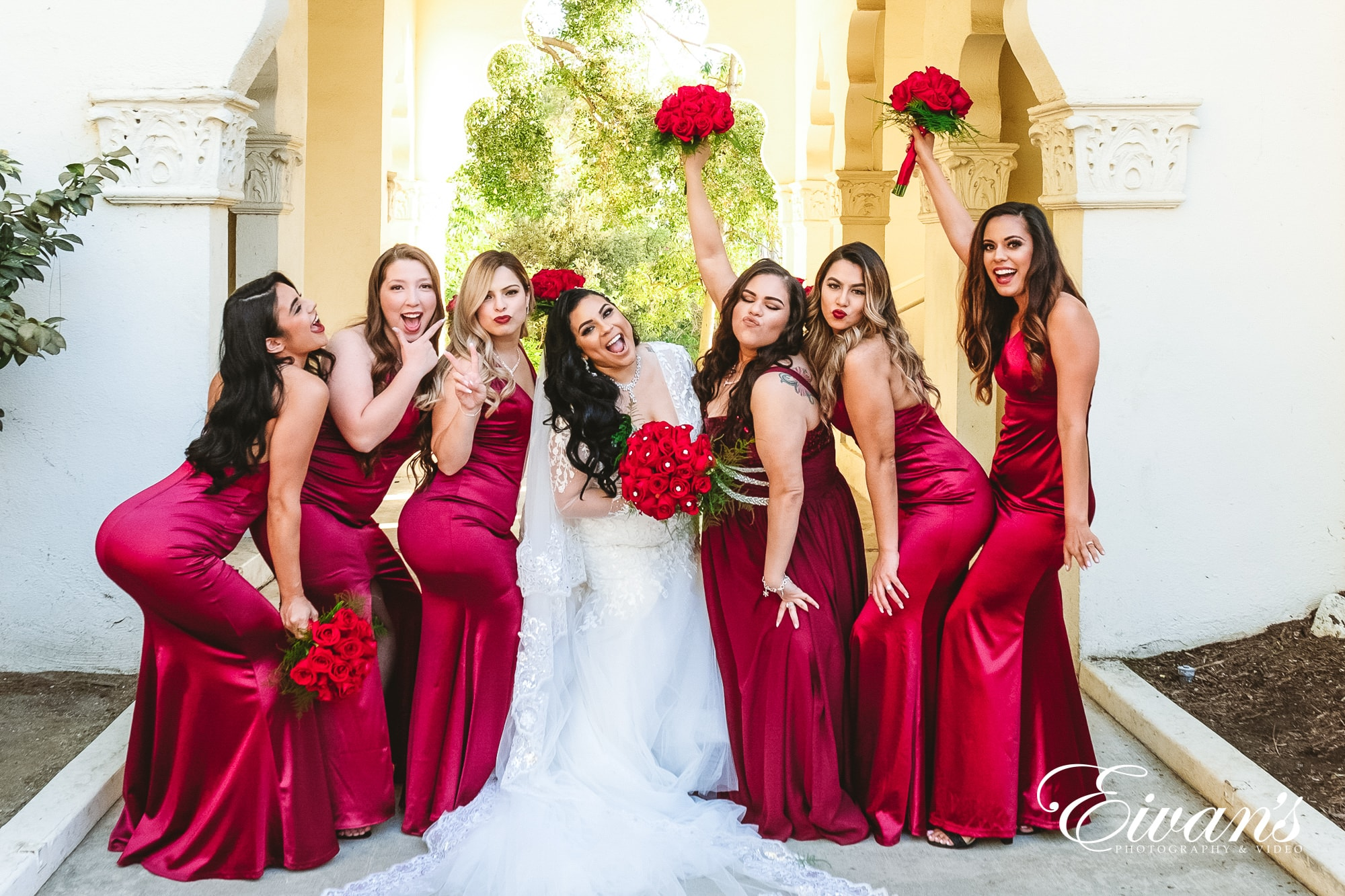 seven women in red dresses