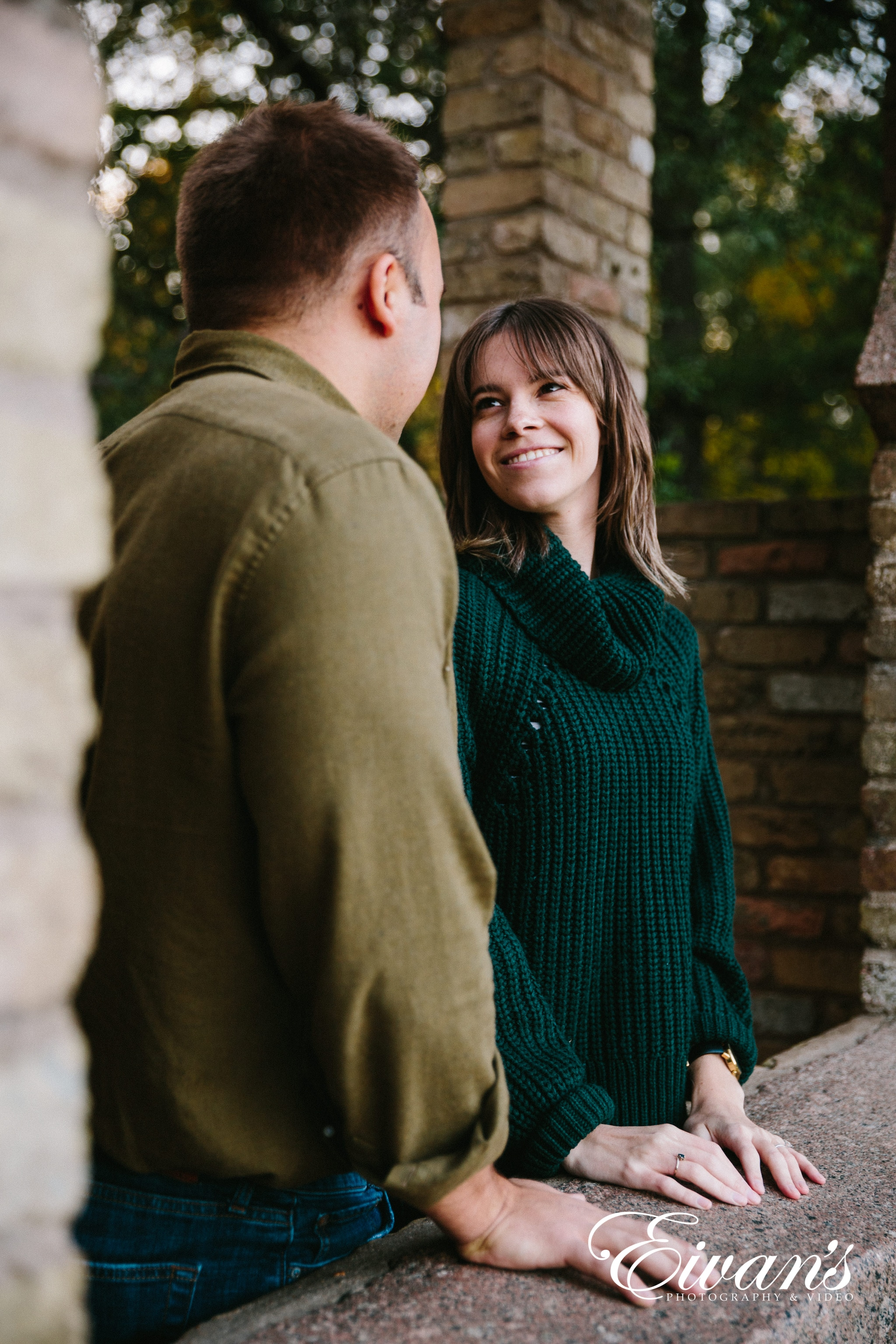 engaged female smiling in her green sweater