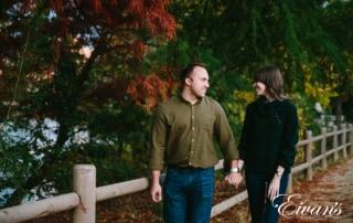 couple walk through a park