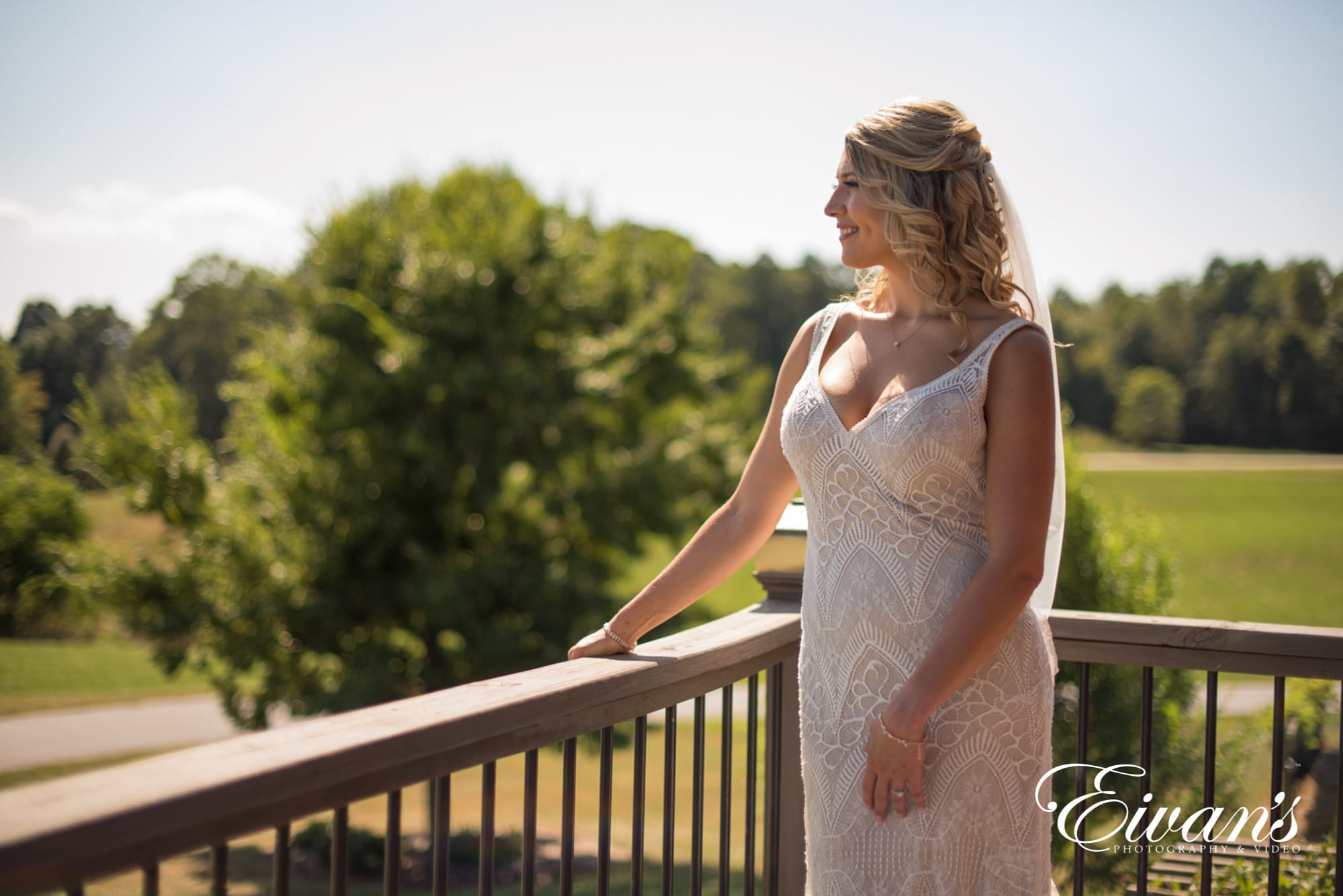 image of a bride looking off into the distance on a balcony
