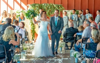 "a couple walking down the aisle after they say ""i do"""