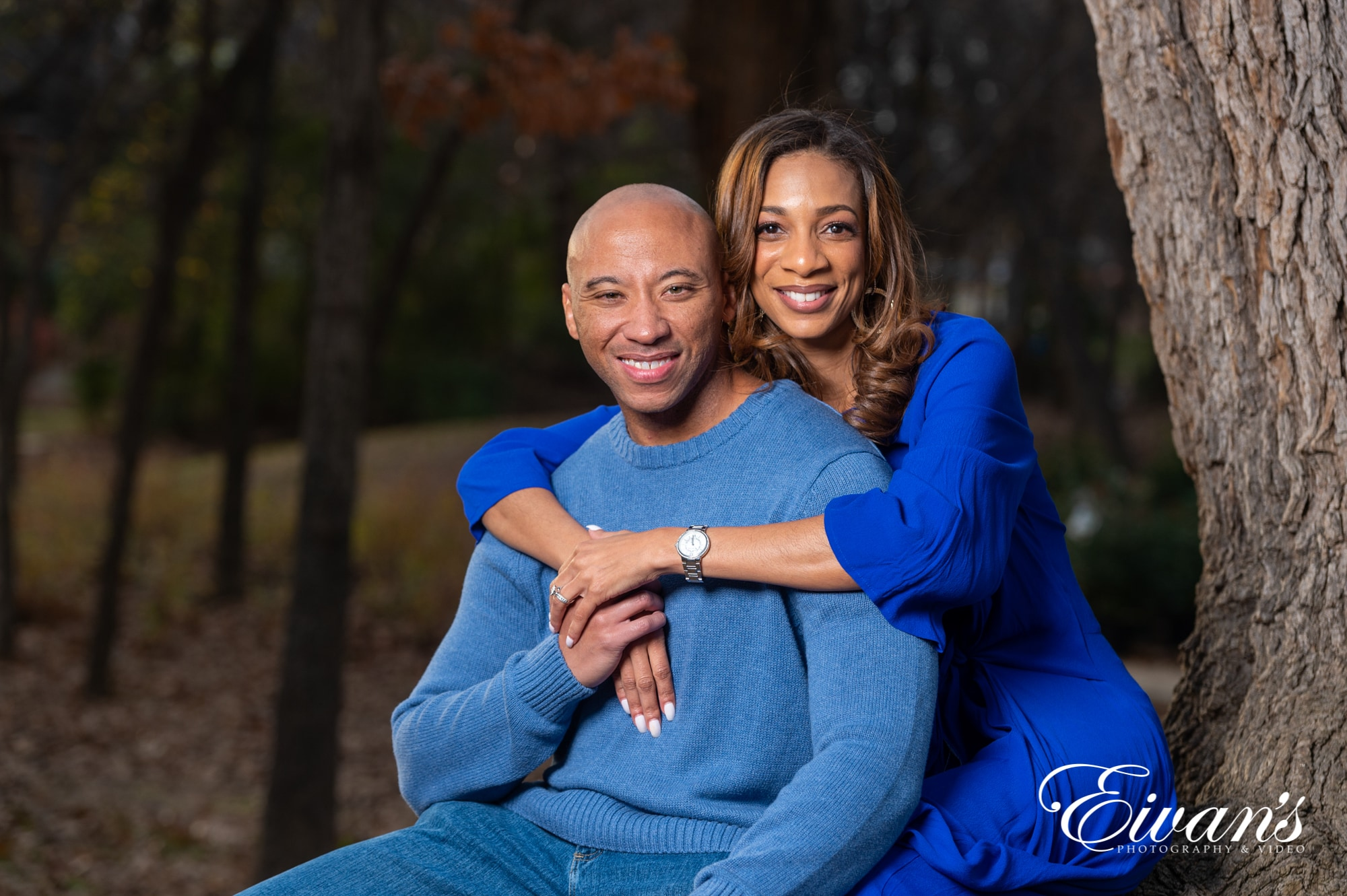 engaged man and woman wearing blue