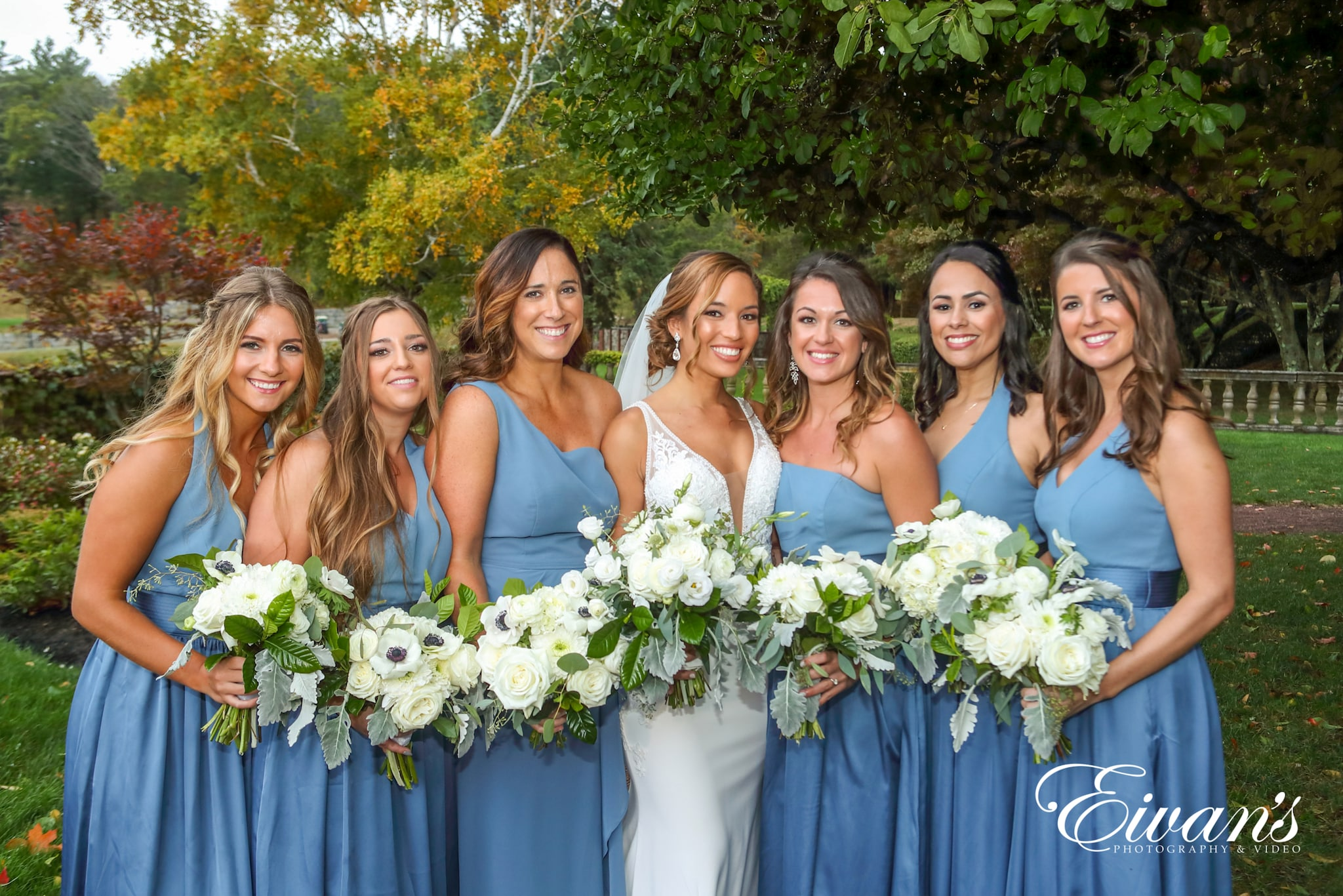 a bride and her bridesmaids lined up for a picture