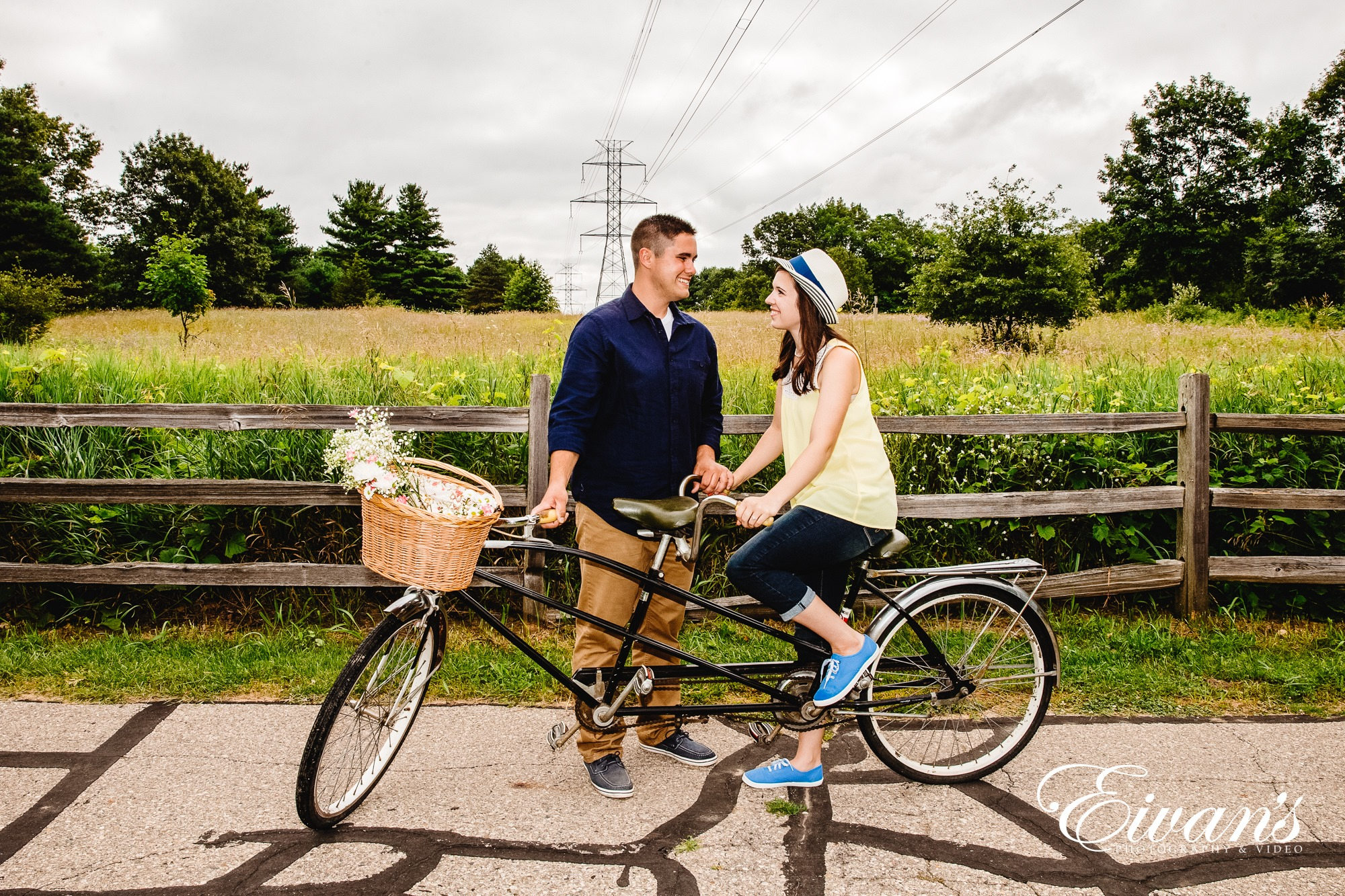 Image of an engaged man and woman on a two person bike