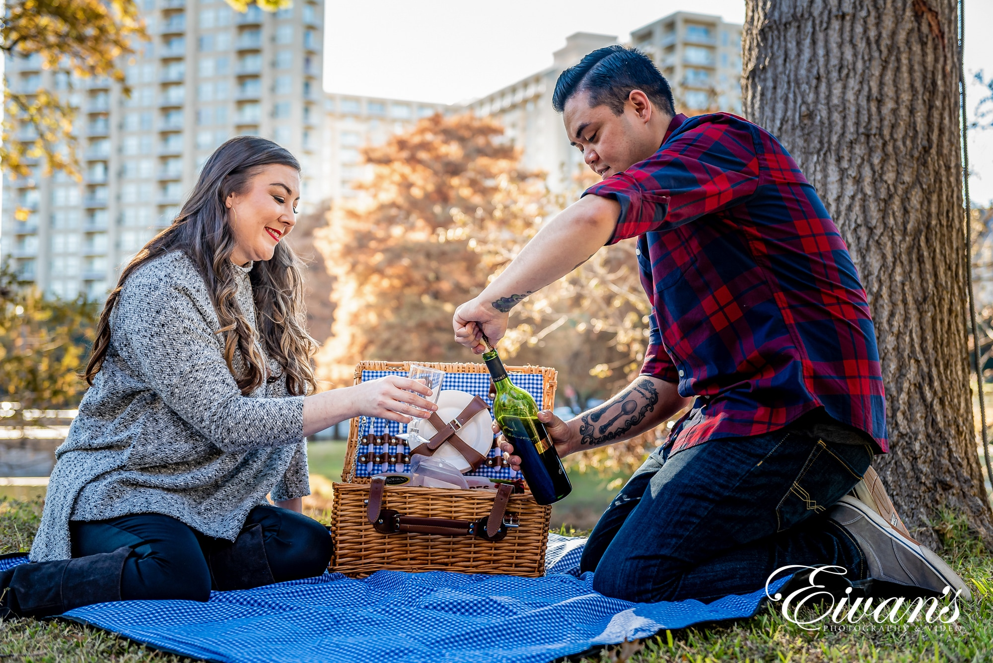 Image of an engaged man and woman having a picnic