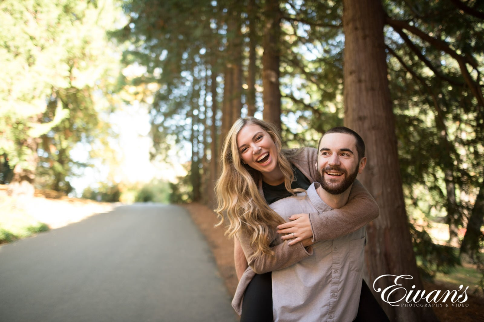 Image of an engaged couple in the woods