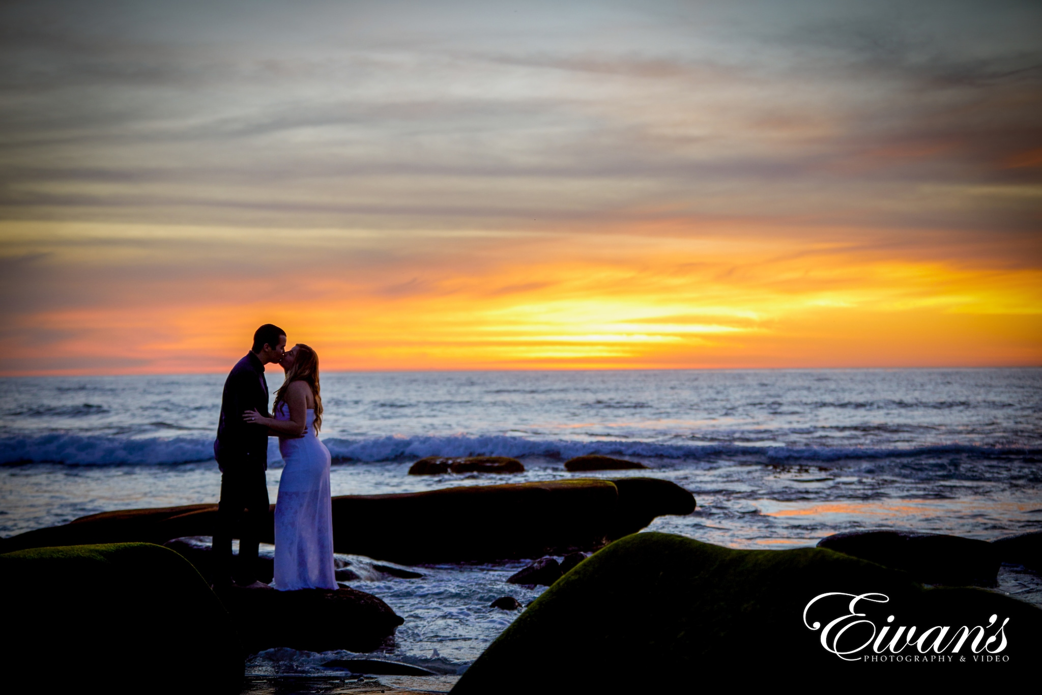 image of a man and woman near a sunset