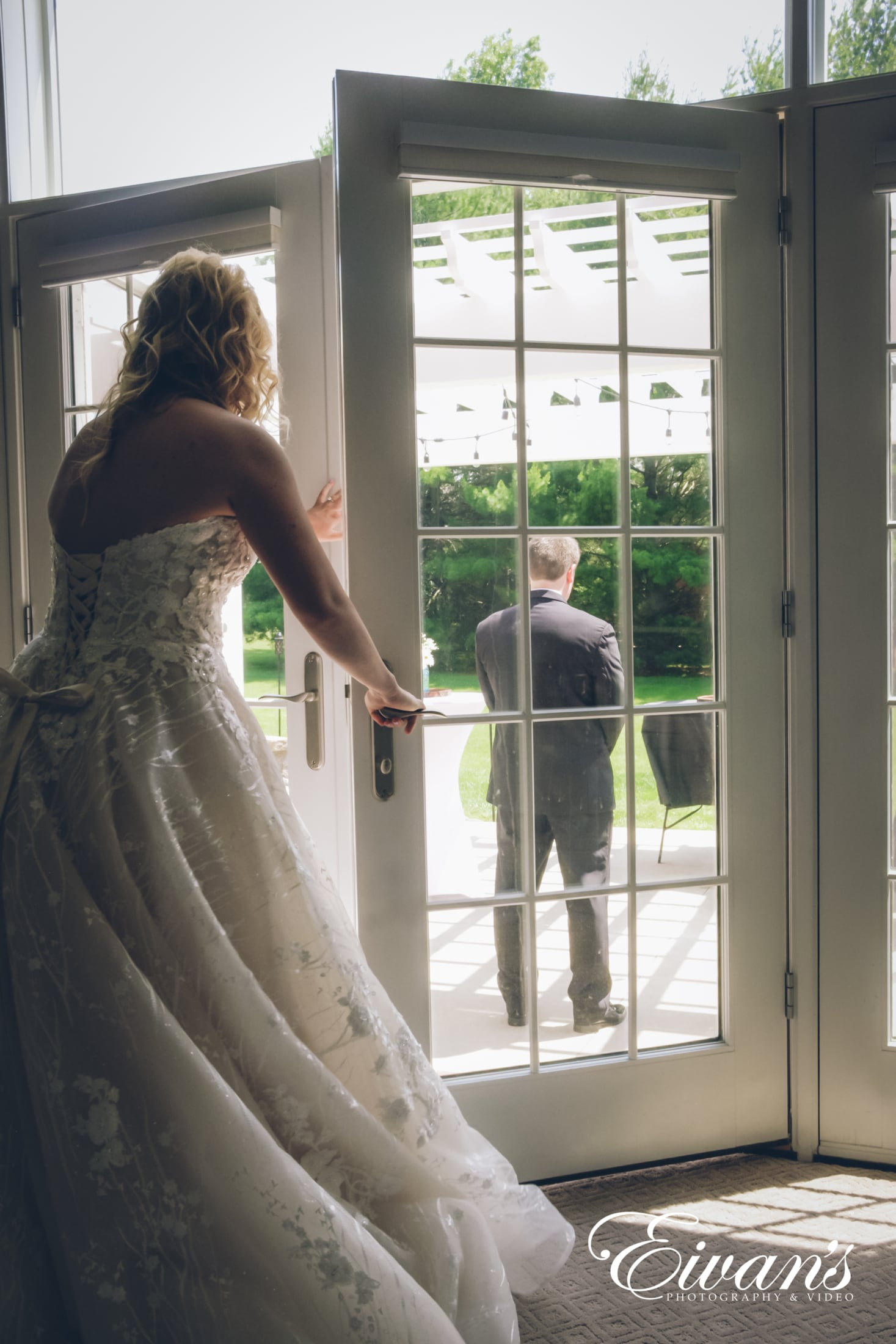 image of bride opening the door