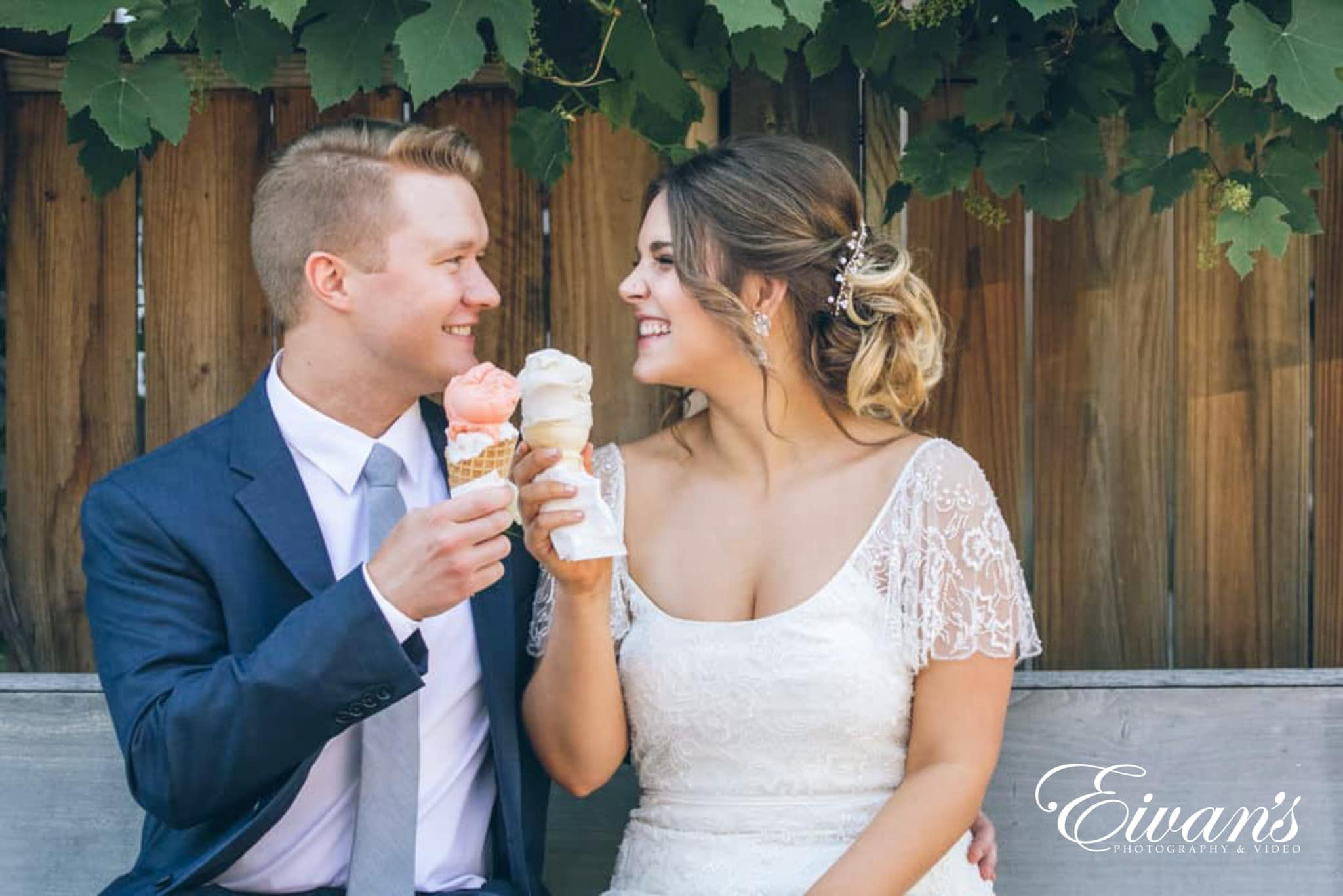 image of a bride and groom cheering to ice cream