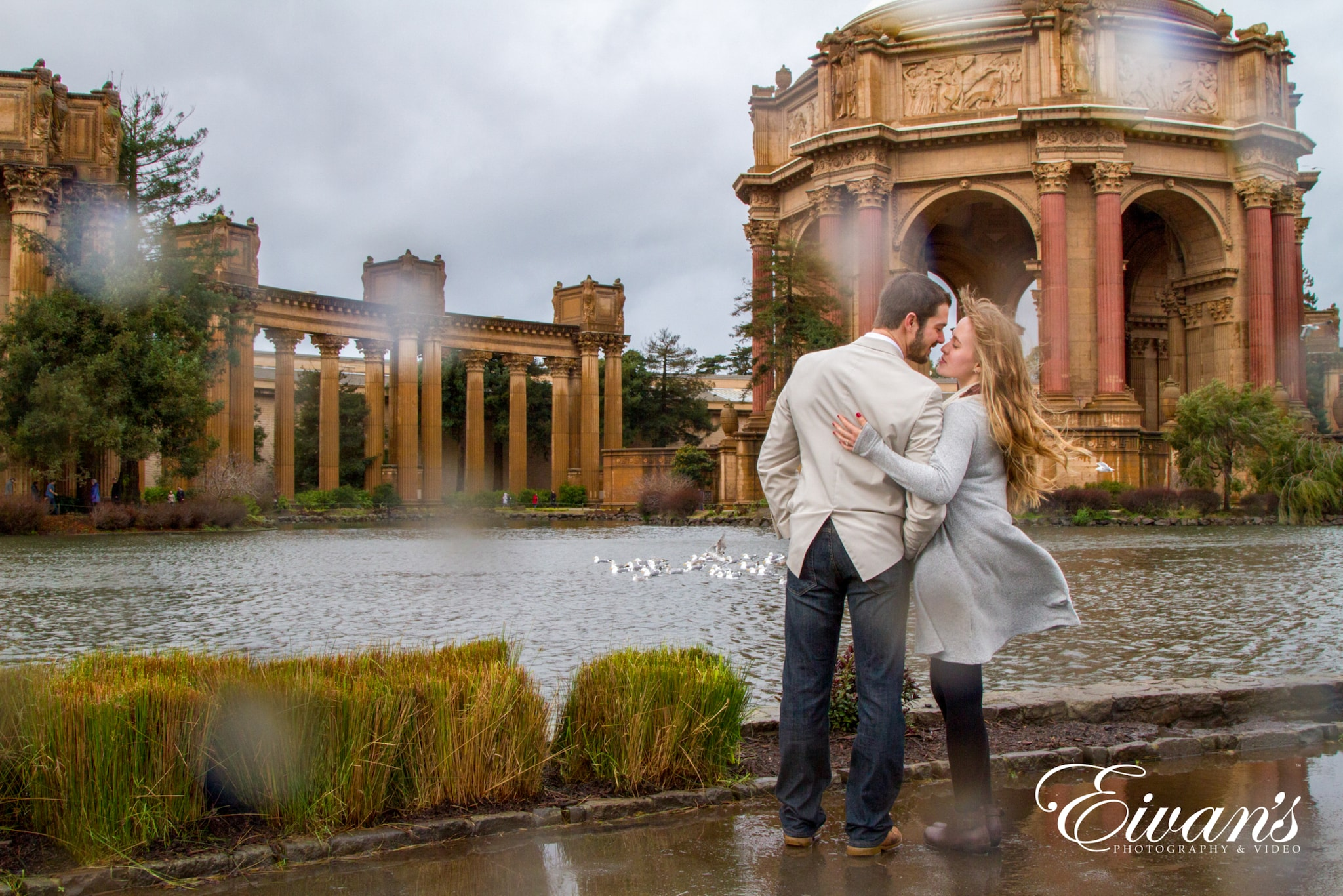 image of an engaged couple in the rain