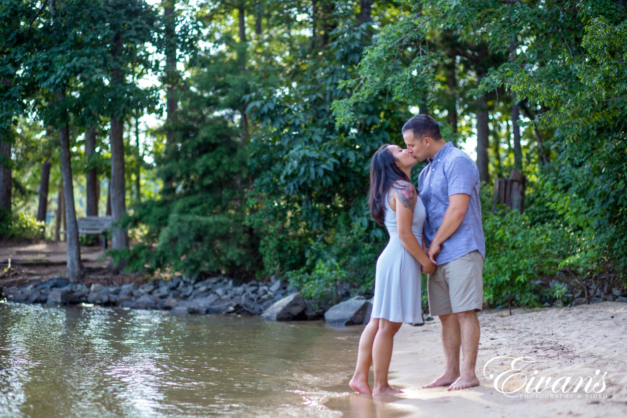 image of engaged couple kissing on the beach