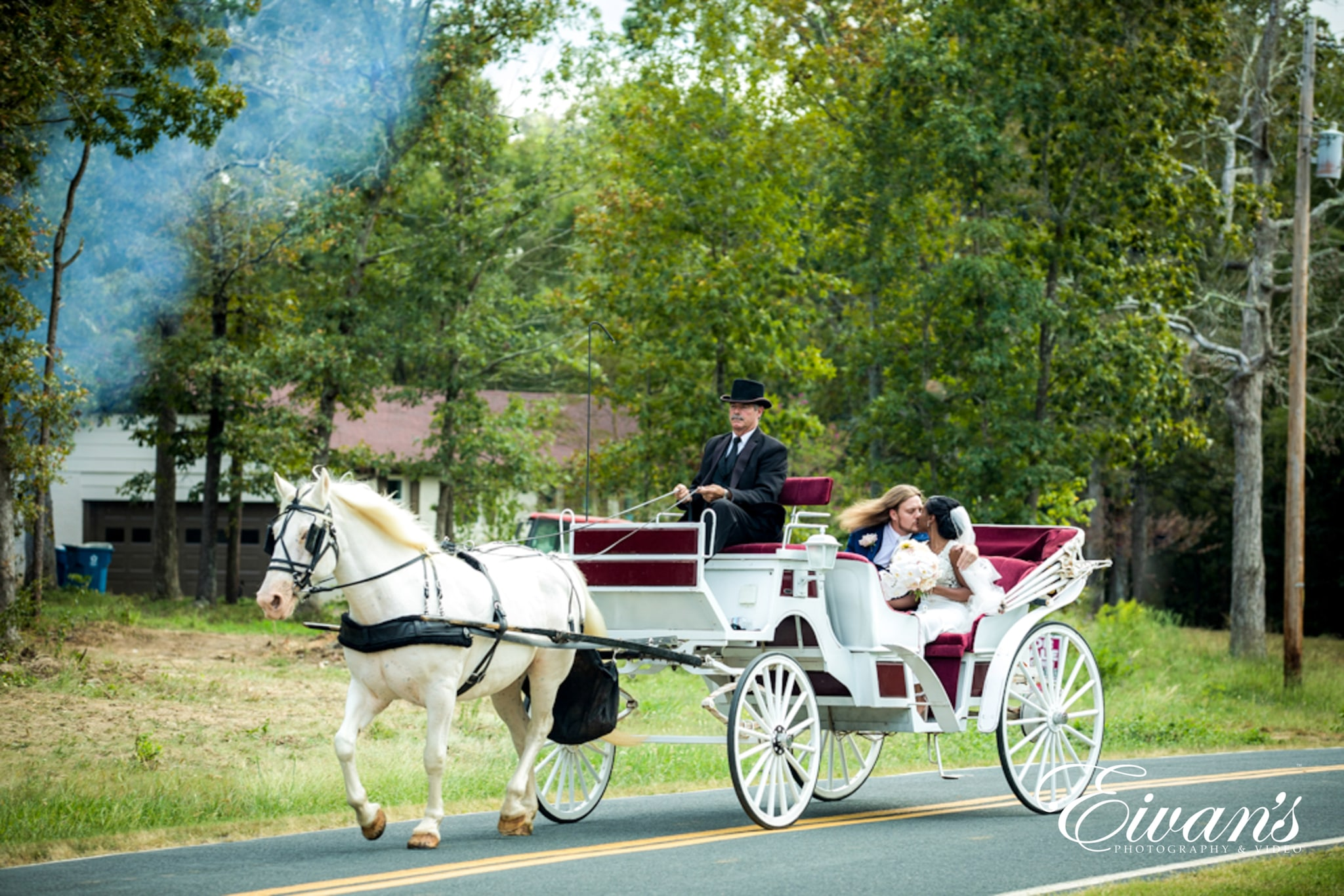 image of bride and groom hitching a ride on a carriage