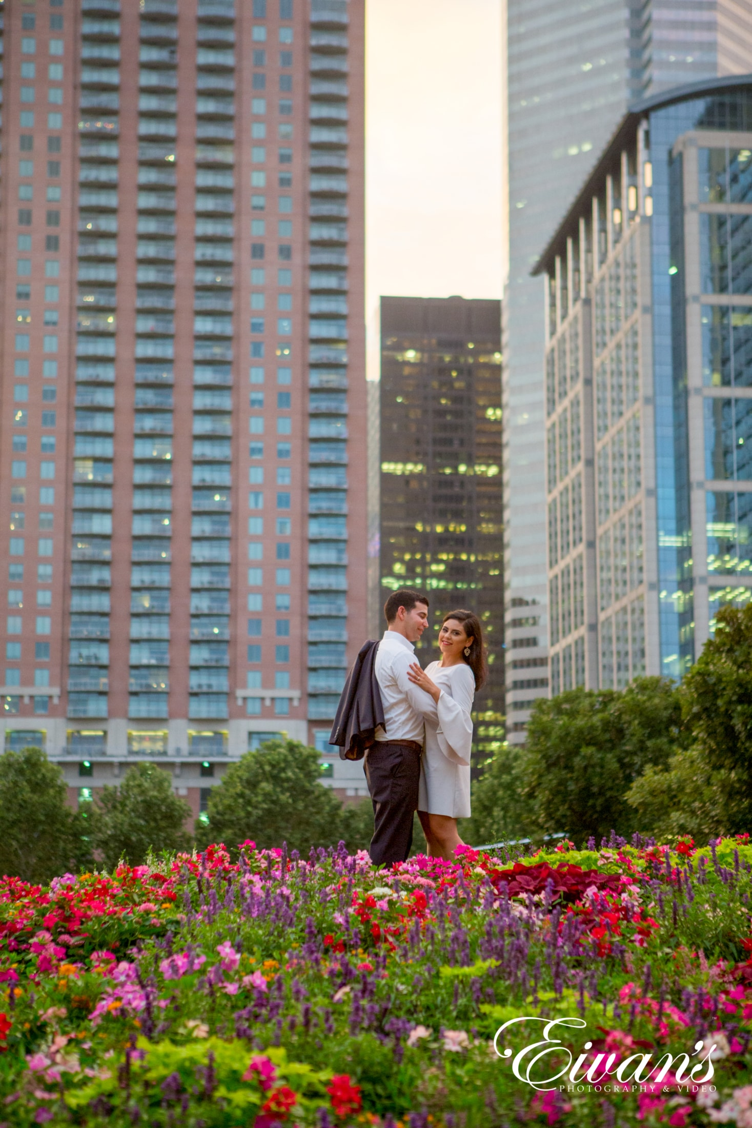 image of engaged couple in a meadow of flowers