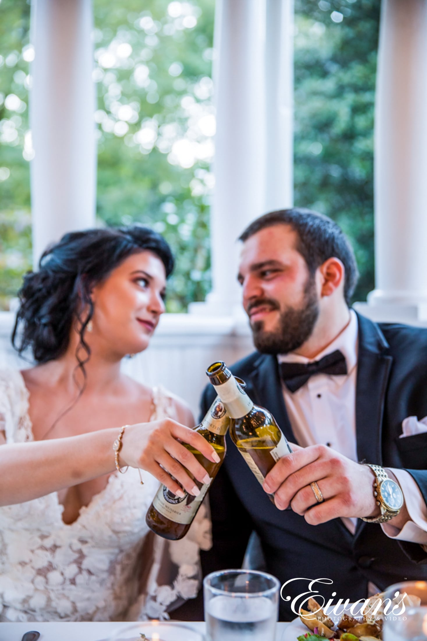 image of a bride and groom cheering a beer
