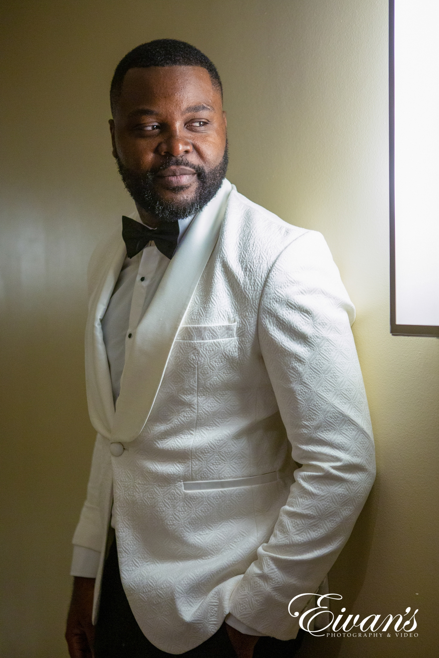 image of a groom in a white jacket