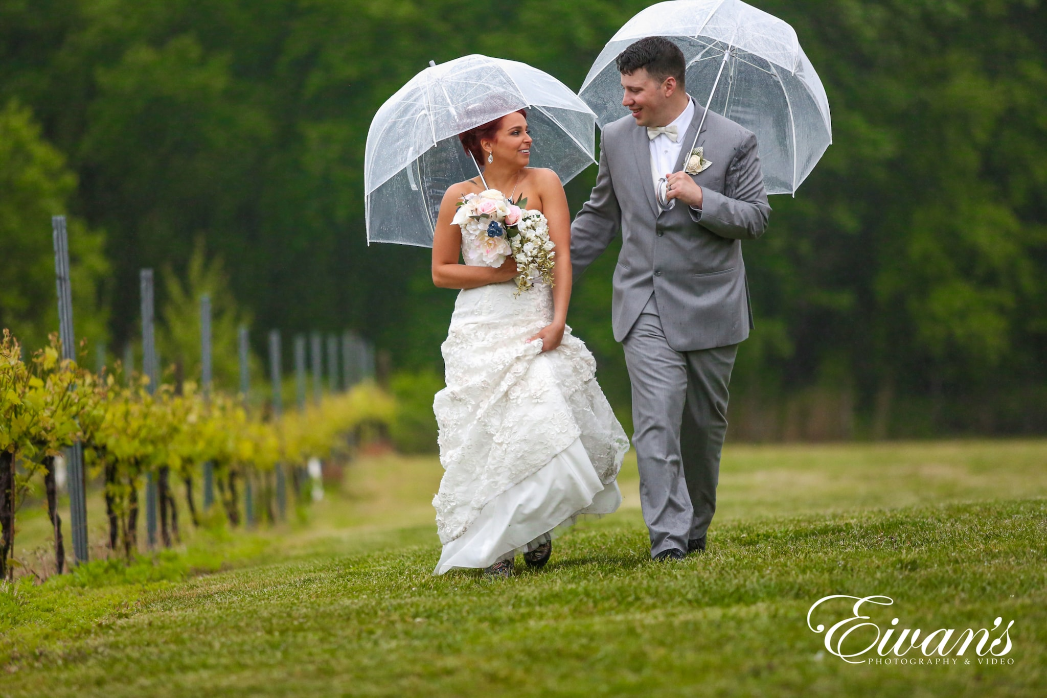 image of a bride and groom walking in the rain