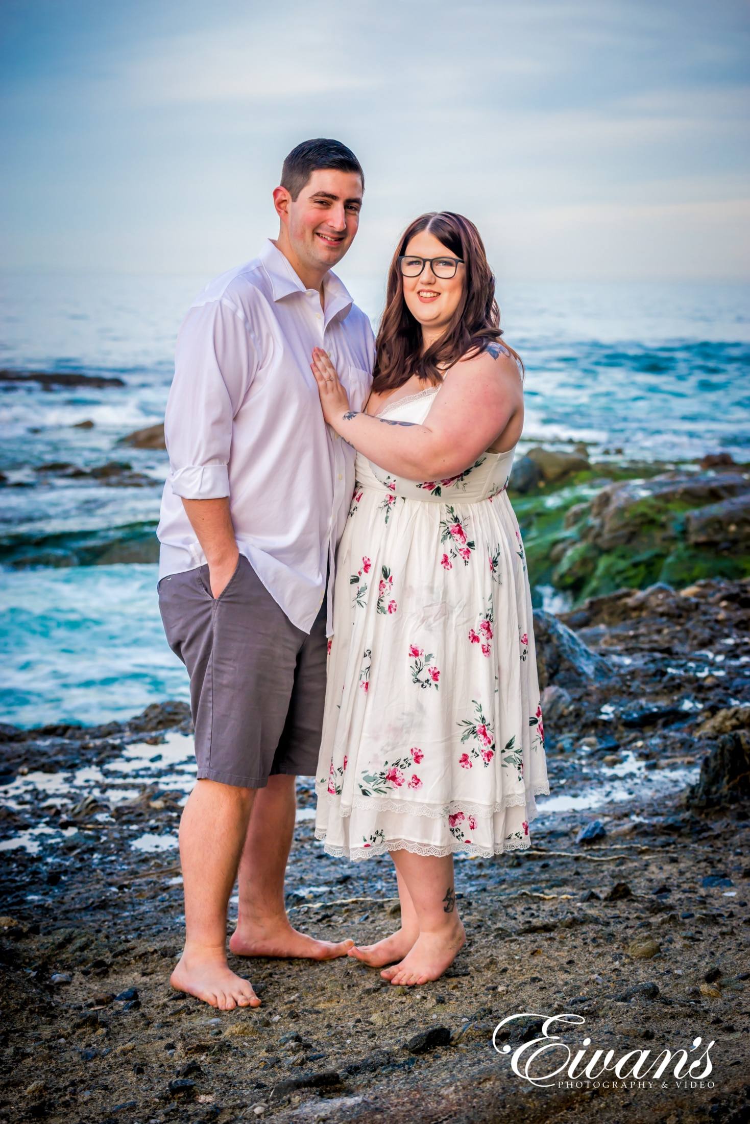 image of engaged couple at the beach