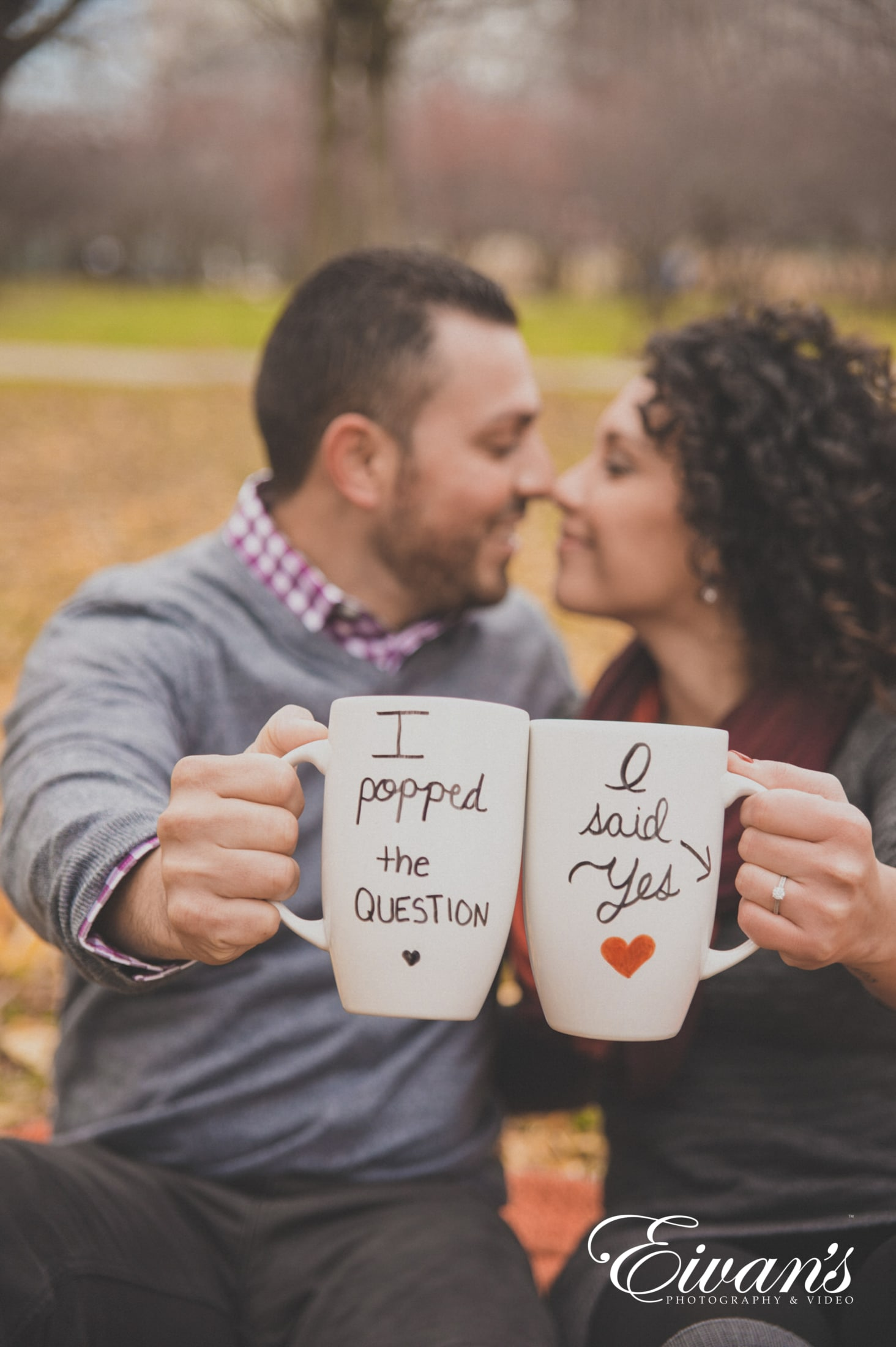 image of a couple kissing and holding mugs