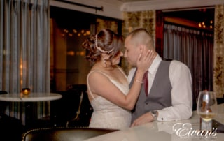 image of a married couple kissing at the casino bar