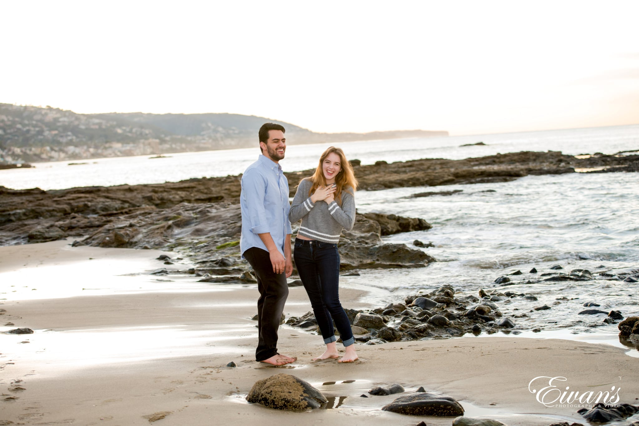 man and woman standing on beach shore during daytime