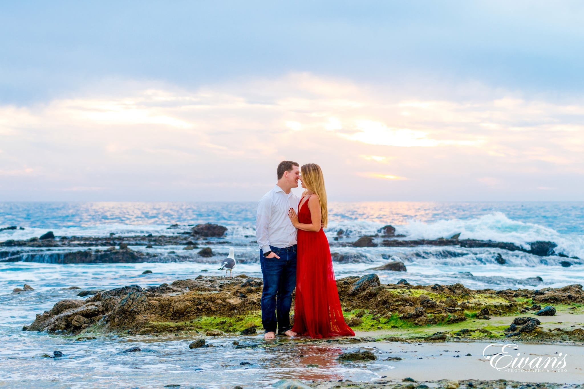 couple standing on seashore during daytime