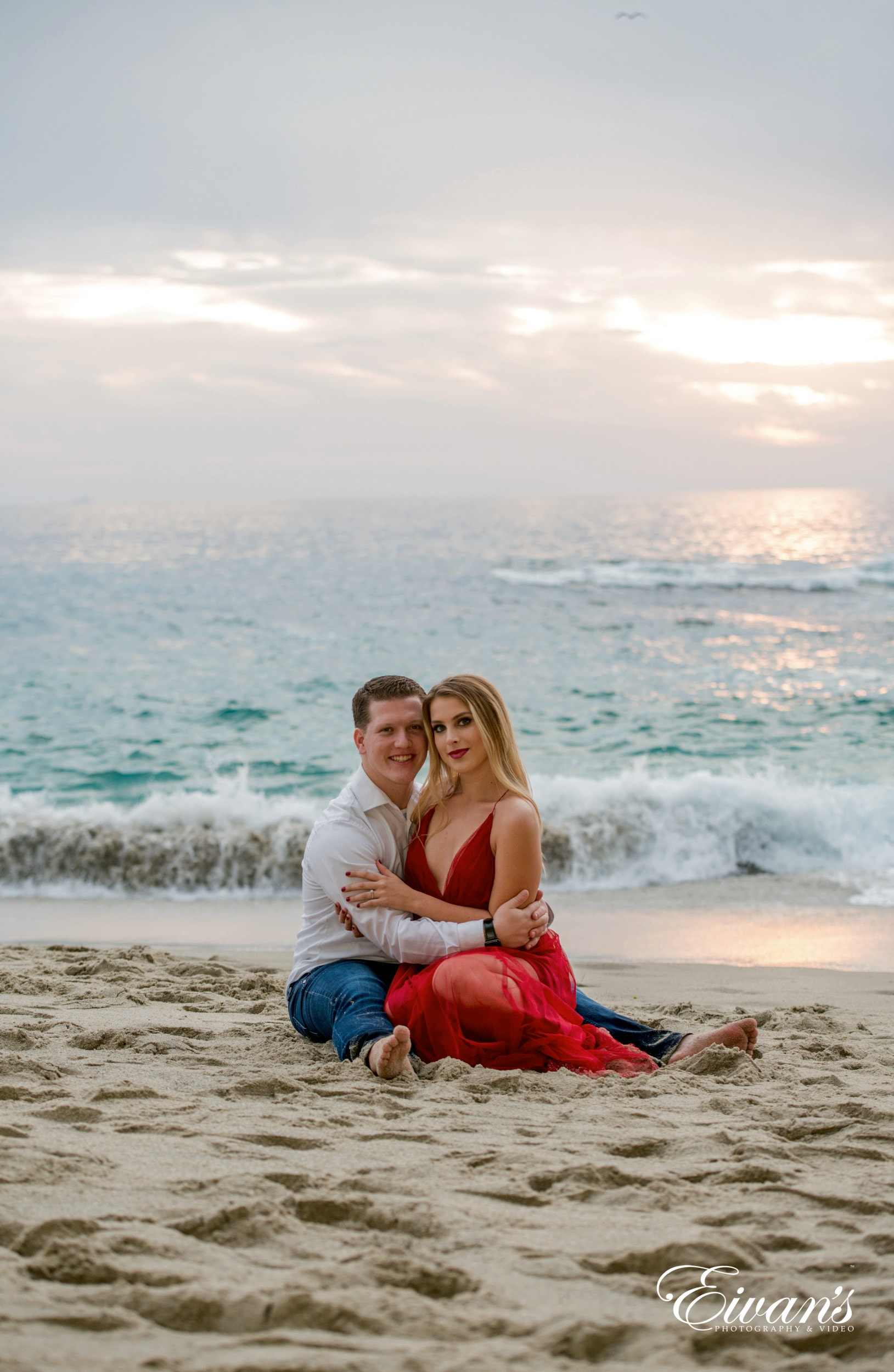 man and woman sitting on beach shore during daytime
