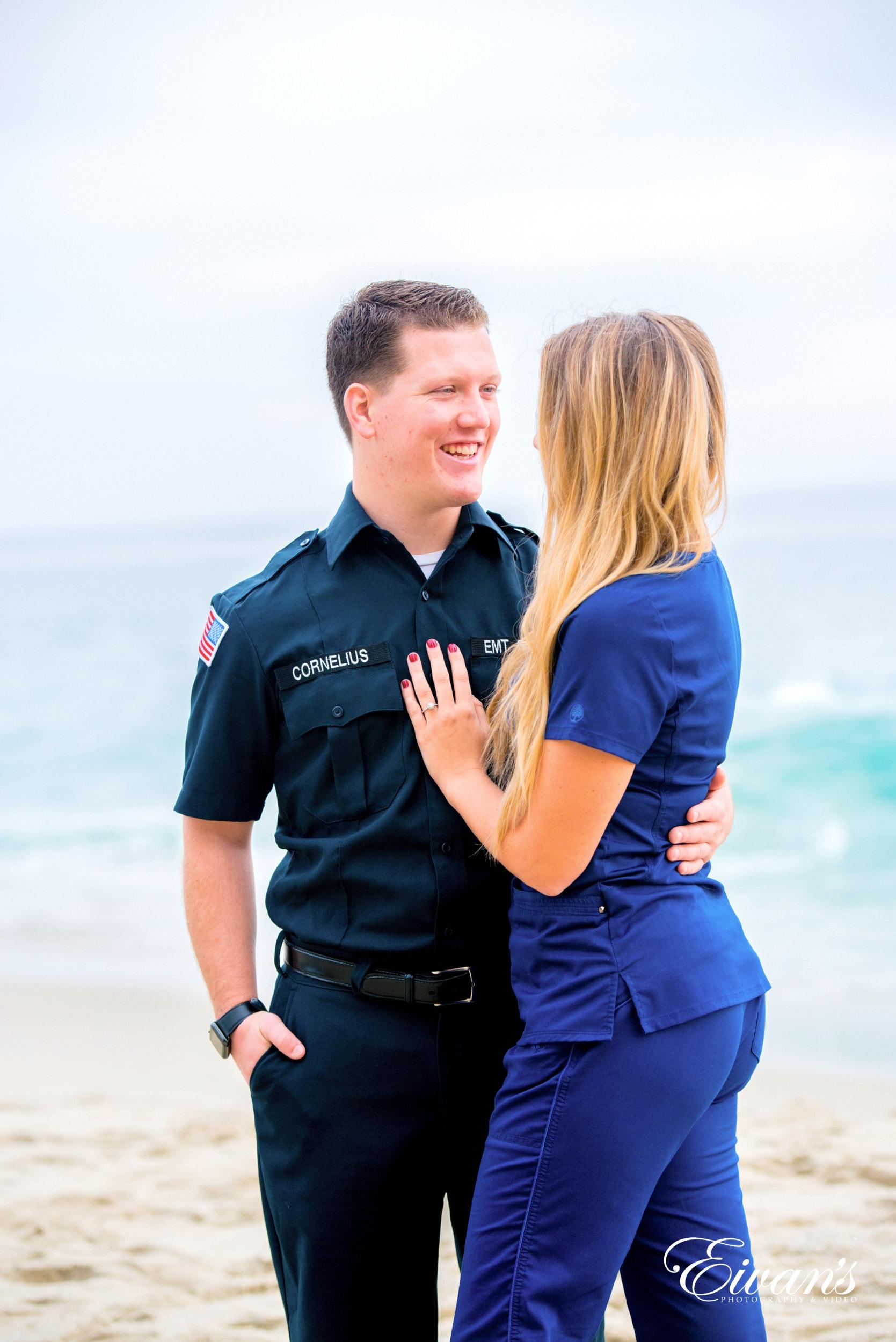 man in black polo shirt hugging woman in blue long sleeve shirt