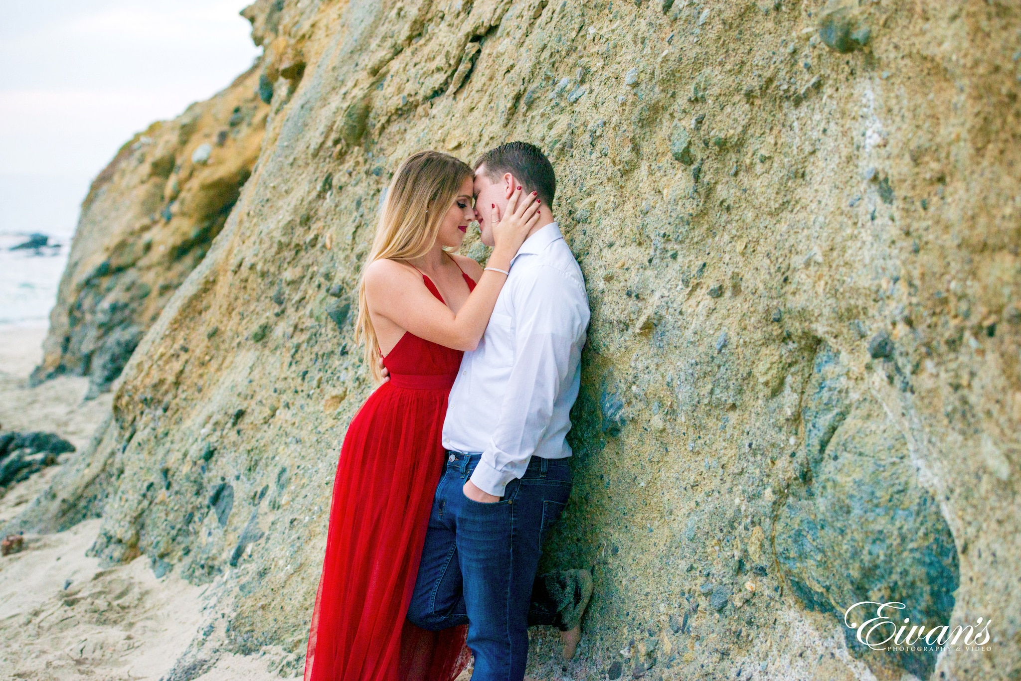 man and woman kissing on brown rock during daytime