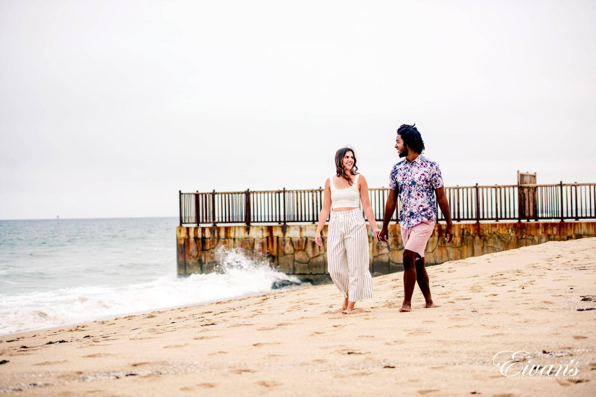 3 women standing on beach during daytime