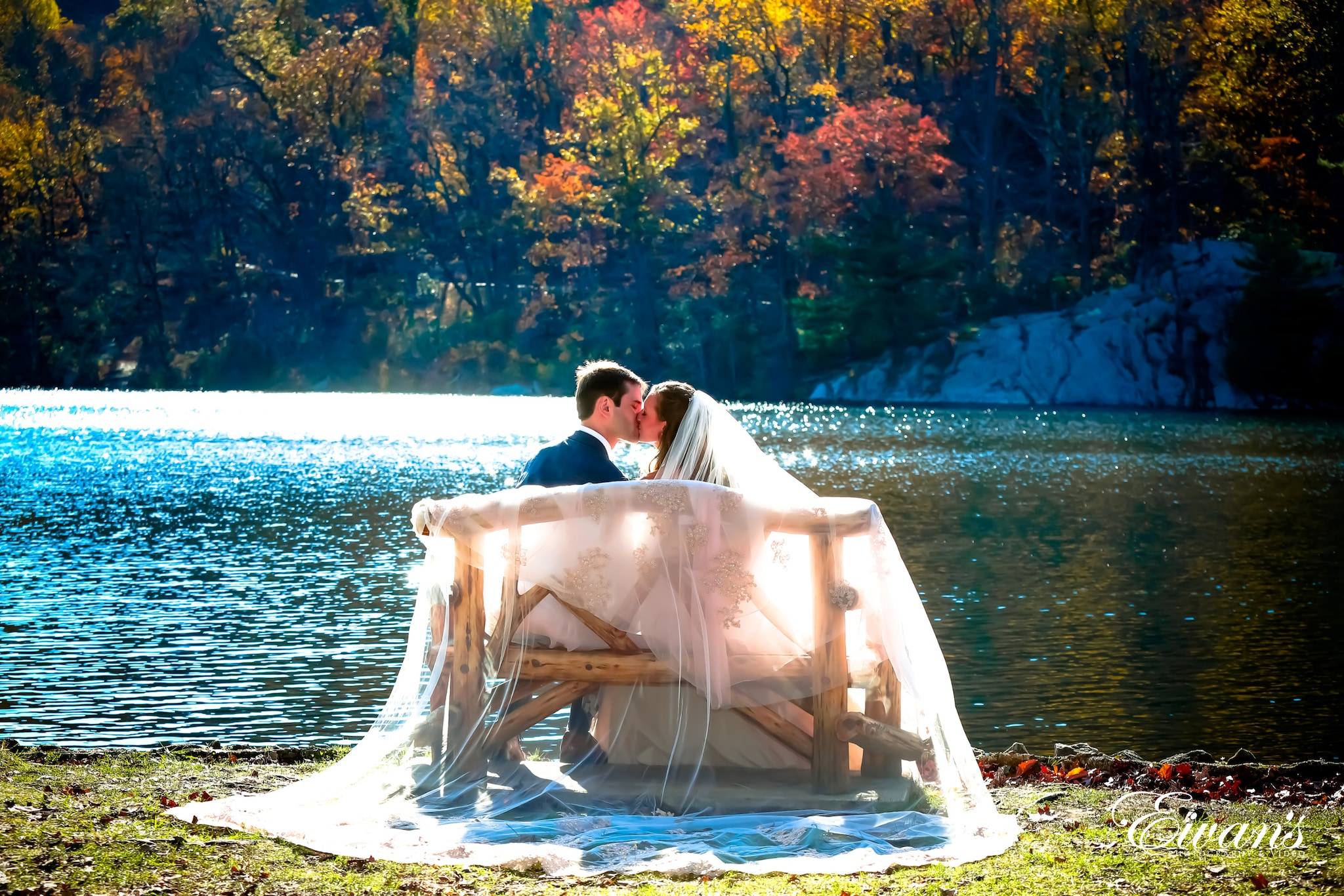 man and woman sitting on white hammock near body of water during daytime