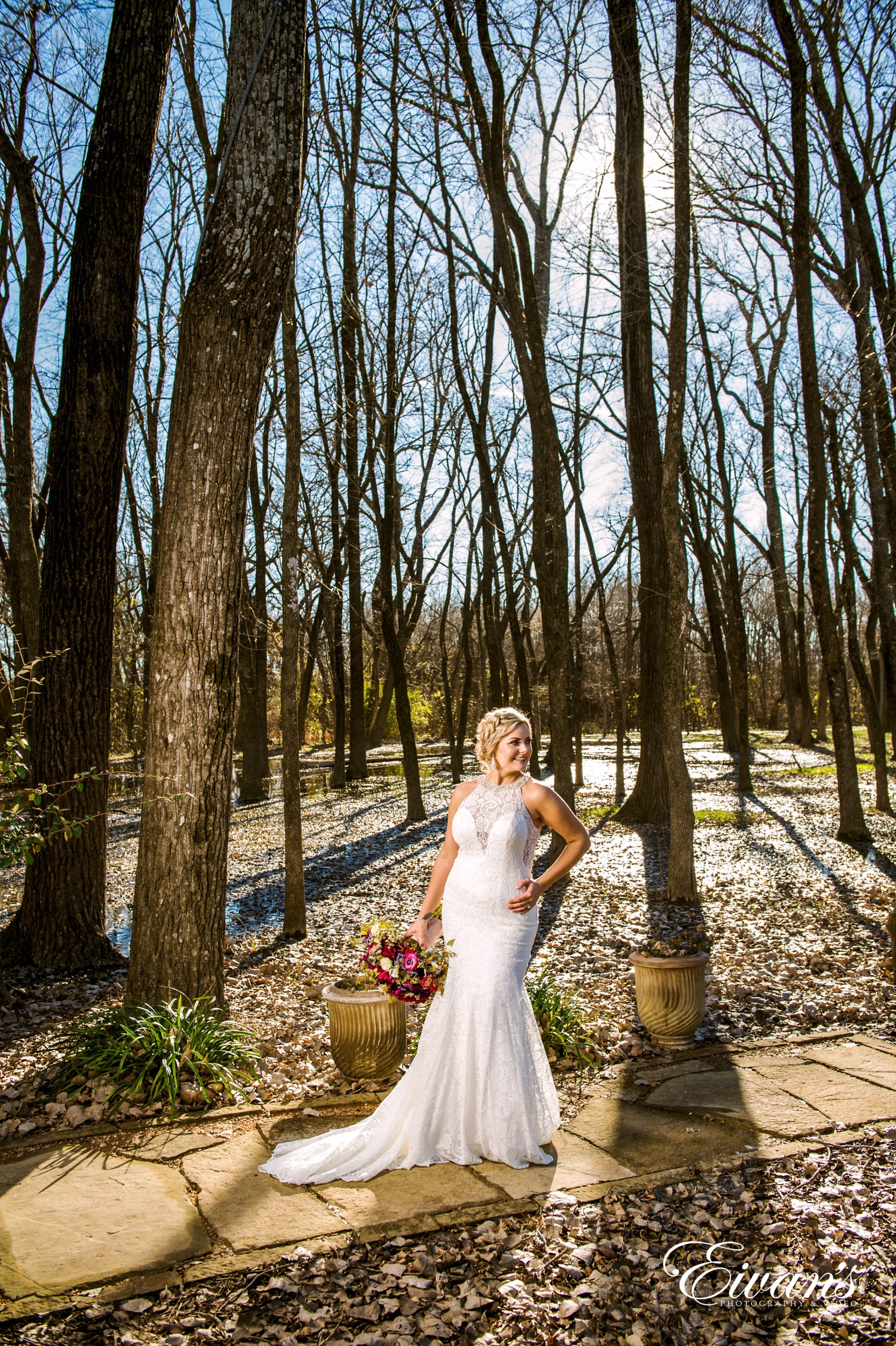 woman in white dress standing on forest during daytime
