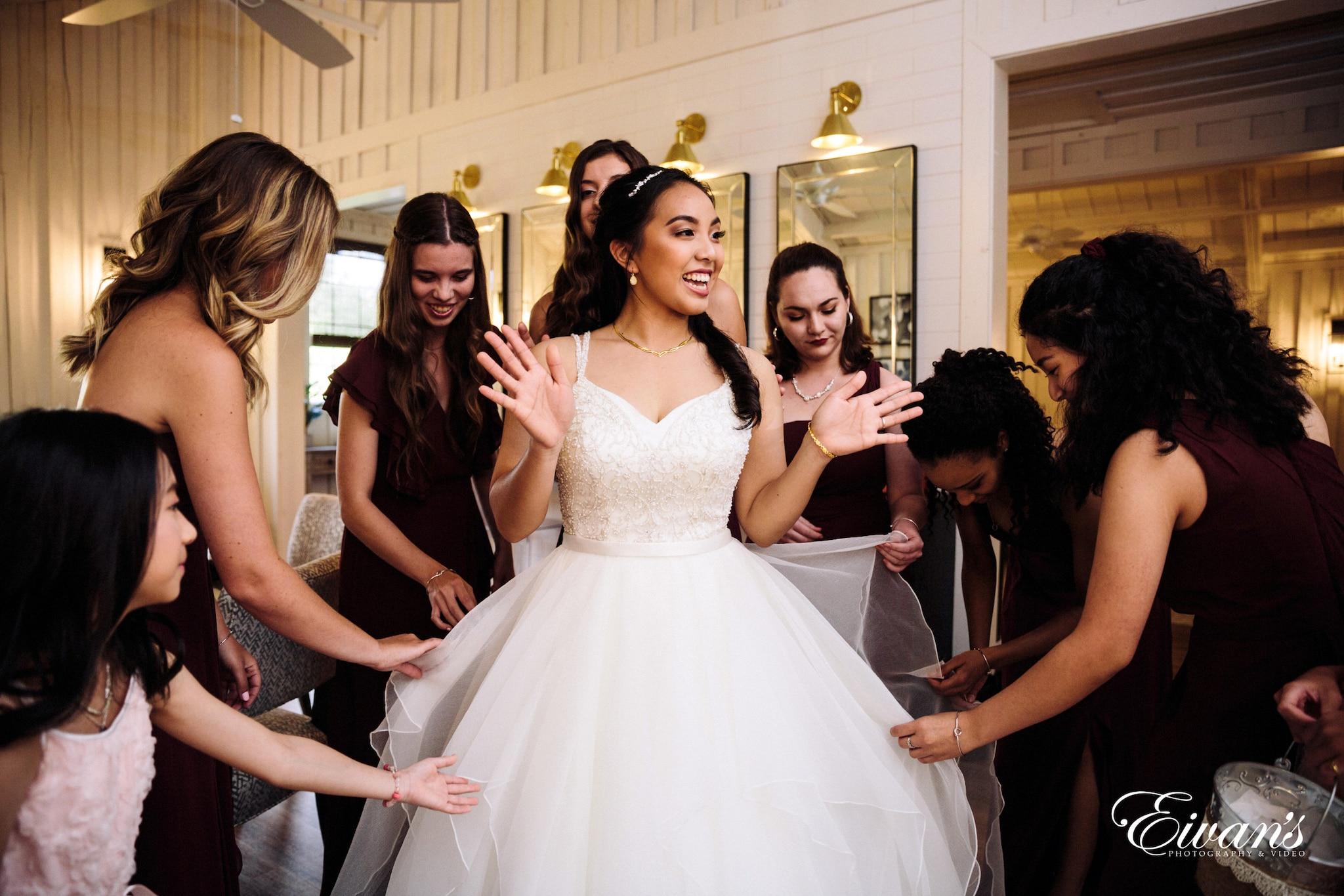 smiling bride with bridesmaid