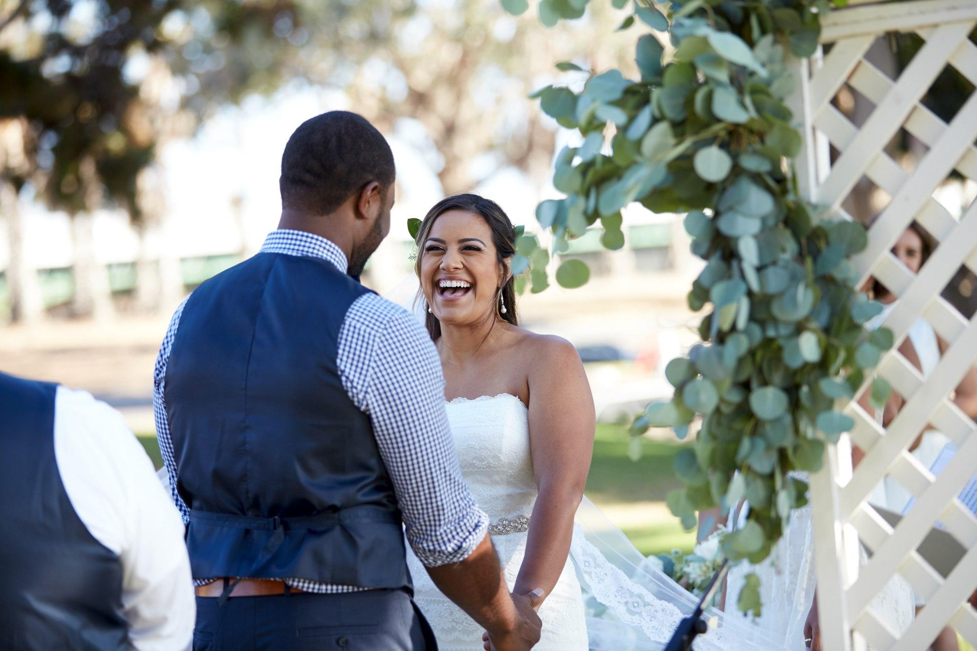 man in blue suit jacket beside woman in white tube dress