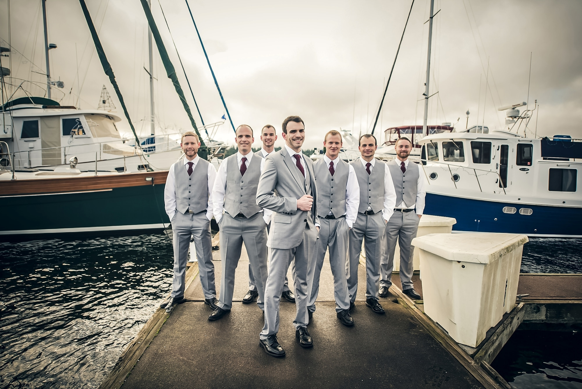 a group of people standing in front of a boat