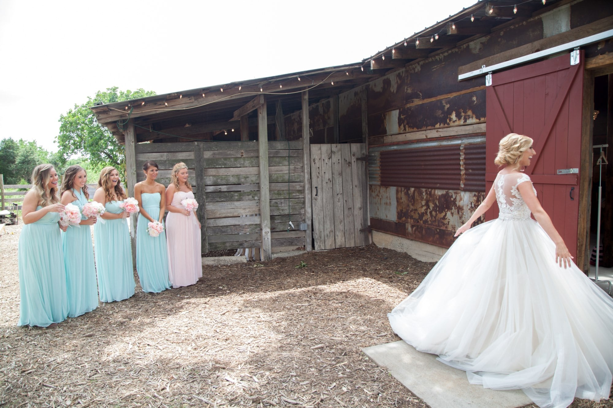 woman in white wedding gown standing beside girl in white dress