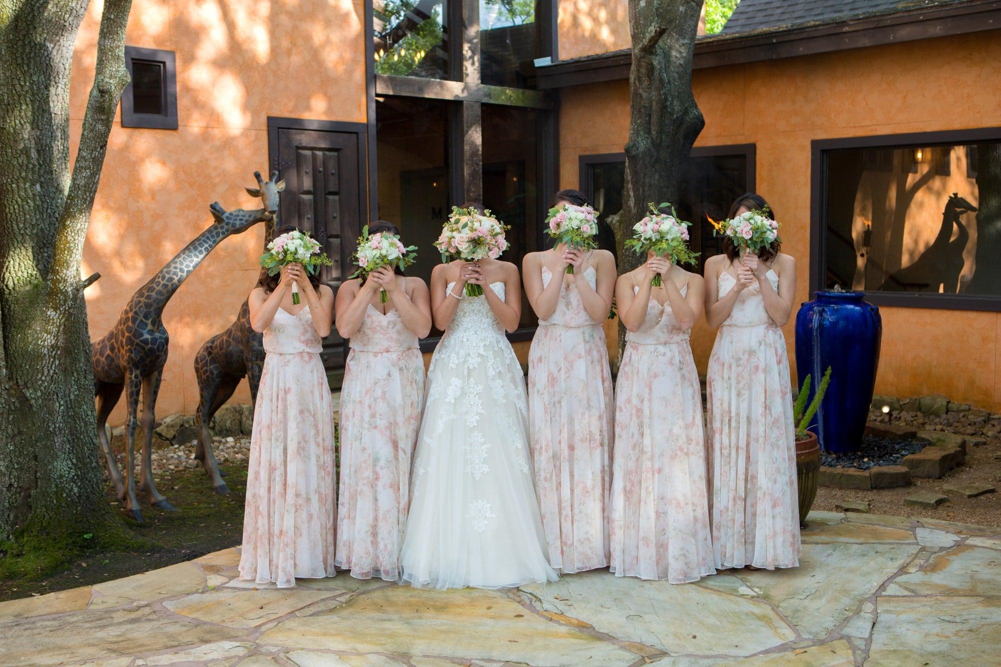 women in white wedding dress standing on gray concrete floor