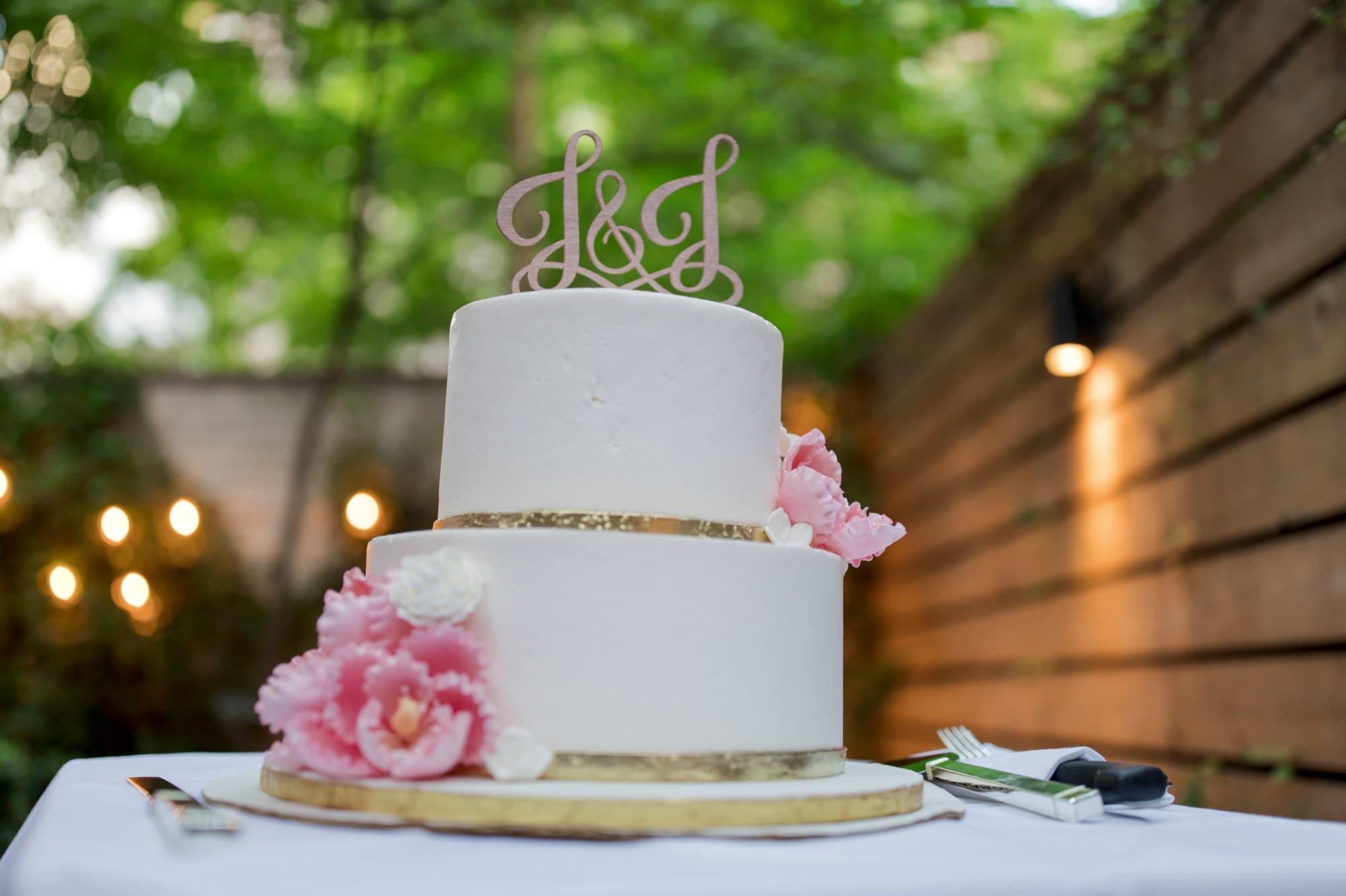 white 3 tier cake on white table